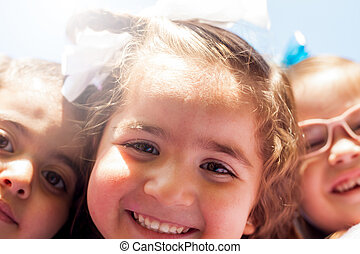 Little girls taking a selfie - Happy little friends trying...