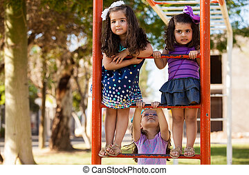 Let's climb these handlebars - Cute group of little girls...