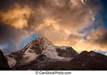 Paramount mountain in peru, during beautiful sunset