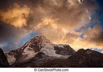 Paramount mountain in peru, during beautiful sunset
