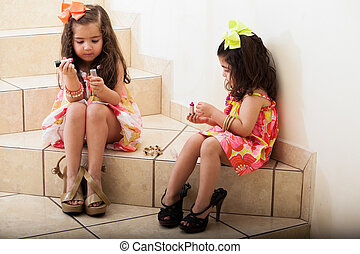 Little girls putting some makeup on - Cute naughty little...