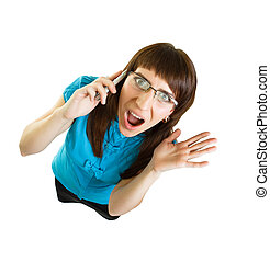 Girl with glasses emotionally speaks on the phone on white...