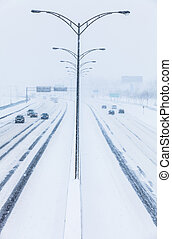 Symmetrical Photo of the Highway during a Snowstorm -...