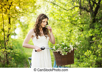 Young woman with bike - Pretty young woman with retro bike...