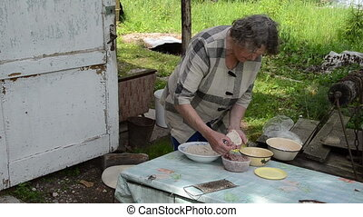 foos potatoes meat senior - Senior old woman prepare...
