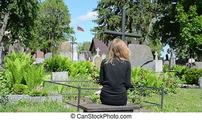 widow soldier grave - Sad woman sit near father grave in...