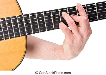 chord - male hand holding a chord on a classsical guitar