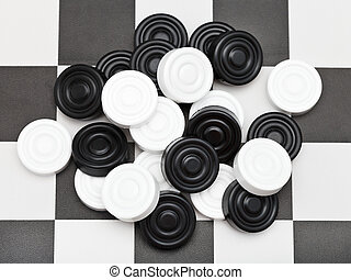 pile of draughts on checkerboard - pile of draughts on black...