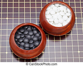 set of black and white go game stones