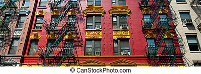 Brightly painted red and yellow building in Chinatown in New...