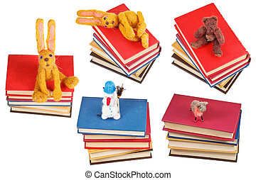 felt soft toys on old books isolated on white background