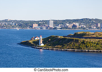Orange and White Lighthouse at Entrance to Halifax Harbor -...