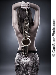 Young woman with saxophone - Topless gorgeous young woman...
