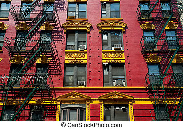 Red and yellow brick apartment building in Chinatown -...