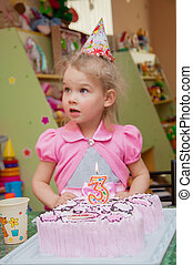 Little girl with birthday cake