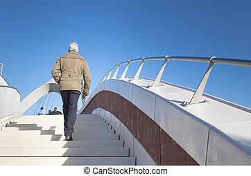 woman climbing stairs to admire the newly build bridge de...