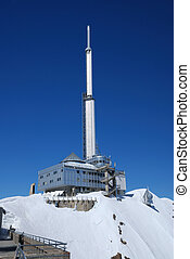 Futuristic mountain view with remote weather station -...