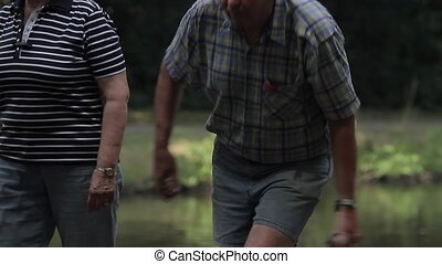 elderly people enjoying boule in a park