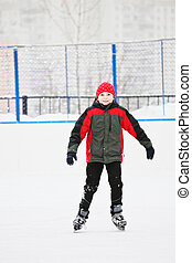Smiling boy on the ice rink - Smiling boy standing on the...
