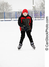 Smiling kid on the ice rink - Smiling kid standing on the...