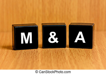 M and A or Merger and Acquisition text on block - MA or...