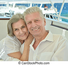 Senior couple having boat ride - Amusing elderly couple have...
