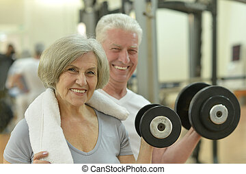 Elderly couple in a gym - Portrait Of A Senior Couple...