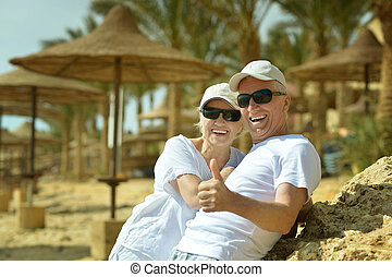 Senior couple at the resort - Senior couple having fun at...
