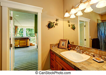 Bathroom with exit to jacuzzi