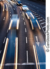 Motion blurred city road traffic (color toned  image)
