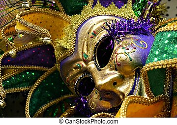 Mardi Gras jester mask - Close up of gold jester's mask with...