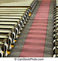 church pews and aisle in sunshine - High angle view of...