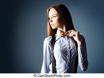 composed - Elegant girl model poses in blouse and bow tie....