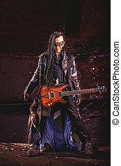 rock guitarist - Modern rock musician playing the guitar...