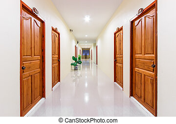 corridor in hotel with rooms entrances from both sides