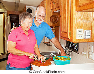RV Seniors - Healthy Lunch - Senior couple preparing a...