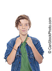 smiling male  teenager with hands on his jacked collar, isolated on white.