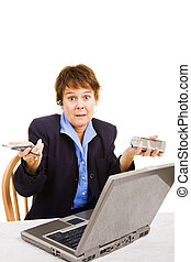 Confused by Business Technologies - Middle-aged woman going...