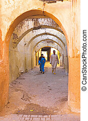 FES, MOROCCO - OCTOBER 22, People walking in the medina in...