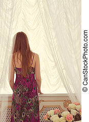 Woman in front of window