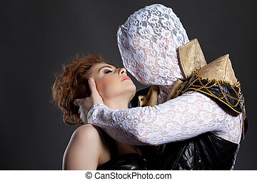 Man with hidden face kissing his redhead partner - Portrait...