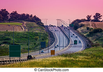 Intercity highway at evening. - Vehicles on intercity...