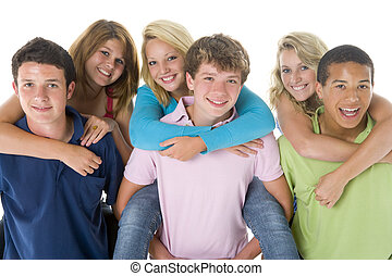 Teenage Girls Piggy Back On Boys
