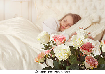 Beautiful sleeping woman in bed with roses - Romance....