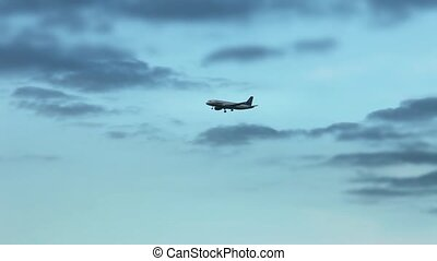 Airplane in the evening sky tracking shot