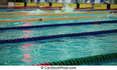 competing in a swimming race - Competitive swimming Mens...