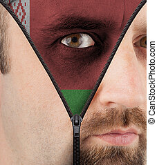Unzipping face to flag of Belarus - close-up of a face...