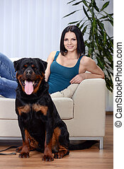 Woman with a Rottweiler dog - Young beautiful woman with her...