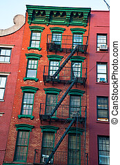 Old apartment buildings - Old brick apartment buildings in a...
