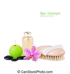 Spa concept orchid with essential oil and zen stones and burning candle isolated on white
